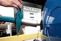 Refuelling liquefied petroleum gas car. Pump being used to refuel a car with a liquefied petroleum gas LPG, in this case propane. Car engines that run...