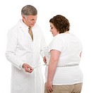 Overweight woman having her waist measured.