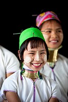 Padaung girl belonging to the Karen sub-tribe wearing a traditional heavy brass necklace with twenty-five rings which elongates the neck. Model releas...