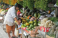A mother and her daughter at a fresh fruit stall, Tagaytay, Philippines