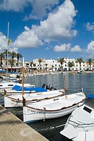 FORNELLS MENORCA Traditional fishing boats anchored at quayside restaurants