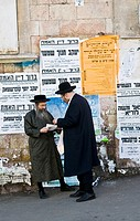Gossiping in one of Mea Shearim neighborhood streets in Jerusalem