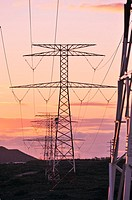 views of pylons and wires at sunset