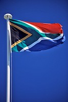 The new, post_1994 South African flag flying against a blue sky
