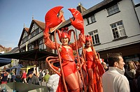 Two women stilt artists dressed as lobsters at the Abergavenny food festival, Monmouthshire south wales UK  September 19 2009
