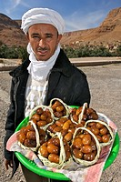 A Moroccan man wearing a traditonal turban and selling dates near the village of Ziz.