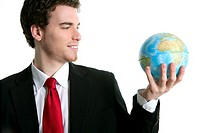 businessman tien suit with world ball global map in hand power communication metaphor