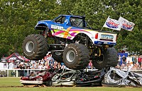 England, Warwickshire, Coventry, The world's no. 1 Monster Truck 'Bigfoot' performing in a car crushing challenge at the Stoneleigh Park Country Festi...