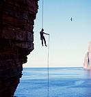 ABSEILING SPORT Abseiler descending Old Man of Hoy seastack Orkney
