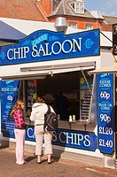 People eating chips from a chip stall at the market in Great Yarmouth , Norfolk , Uk