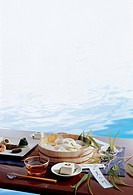 Japanese meal arranged on table beside water