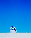 Two snowmen in the snow