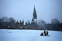 Scotland, City of Edinburgh, Edinburgh, People walking through a snow storm on Bruntsfield Links in Edinburgh.
