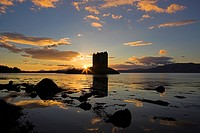 Scotland, Argyll and Bute, Port Appin, The Sun Setting behind Castle Stalker, one of the best_preserved medieval tower_houses surviving in western Sco...