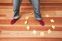 Man foot in circle of adhesive notes