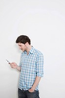 Man texting message on mobile phone