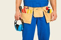 Man wearing tool belt and holding ear muff, mid section, close_up