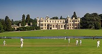 England, Essex, Saffron Walden, A cricket match played in front of Audley End house.