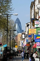 England, London, Whitechapel, A view along Whitechapel Road towards the Gherkin Swiss Re Building in the City of London in the distance.