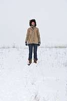 A woman standing on a snowy hill, portrait