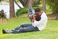 fort lauderdale, florida, united states of america, a father playing with his young son