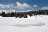 kananaskis country, alberta, canada, snow drifts and mountains