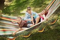 edmonton, alberta, canada, three girls playing in a hammock