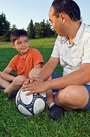 Father and son at the park with a soccer ball