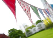 England, West Midlands, Edgbaston, Bunting hanging in the Botanical Gardens in Edgbaston, Birmingham