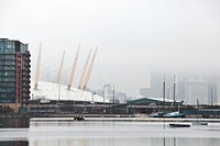 England, London, Greenwich Peninsula, A foggy morning view across the River Thames towards the O2 arena and Docklands.