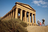 Tursitas in the temple of Concord Valley of the Temples Agrigento Sicily Italy