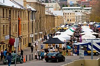 Historic sandstone warehouses fronting the Saturday market in Salamanca Place Hobart Tasmania