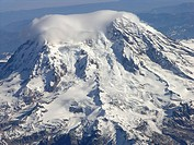 USA, Washington State, cloud hovering above snow covered Mount Rainier, aerial view
