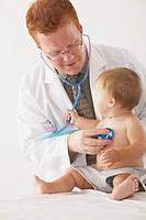 a pediatrician examining a baby