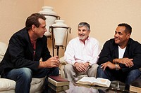 men in a home bible study
