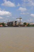 Buildings at construction site, Hooghly River, Kolkata, West Bengal, India