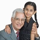 Senior man smiling with his granddaughter