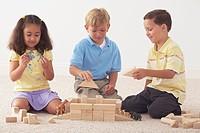 three children building noah´s ark with wooden blocks
