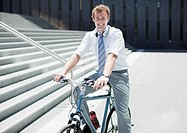 Businessman sitting bicycle