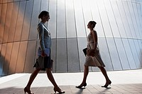 Businesswomen walking outdoors