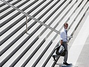 Businessman walking down steps outdoors