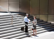 Business people talking on steps outdoors