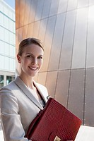 Businesswoman holding briefcase