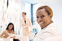 Businesswomen working in conference room (thumbnail)