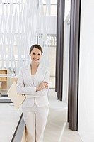 Smiling businesswoman in modern office