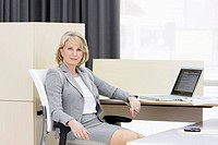 Businesswoman sitting at desk in office