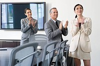 Business people clapping on office conference room