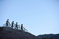 Four mountain bikers on a hill (thumbnail)