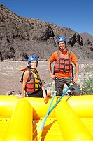 Man and woman ready for white water rafting
