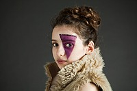Young girl wearing purple face paint